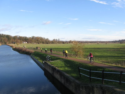 Group riding by canal