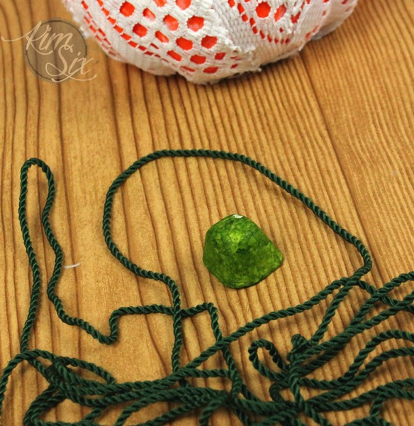Styrofoam pumpkin wrapped in yarn