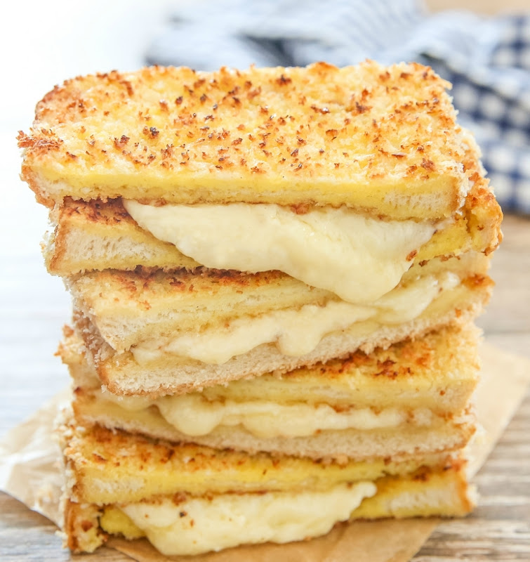 a stack of panko crusted grilled cheese sandwiches