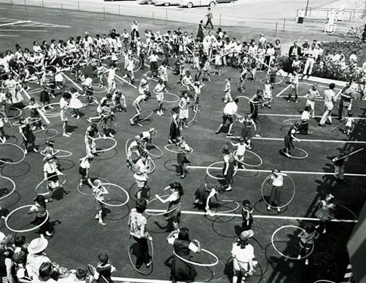 "At the height of the hula hoop craze, various techniques are demonstrated in Los Angeles Aug. 20, 1958 as children ranging from 2 to 16 years old competed for prizes on ""Art Linkletter's House Party"" show.  Groups including the Girl Scouts, Brownies, Blue Birds and Campfire Girls were represented. (AP Photo)"