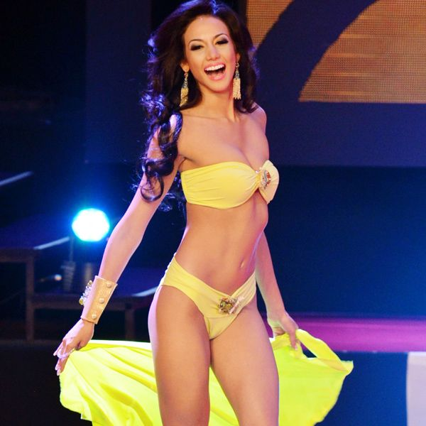 Miss Veraguas, Carolina Brid sizzles in yellow bikini at the Miss Panama beauty contest, held in Panama City, on April 30, 2013.