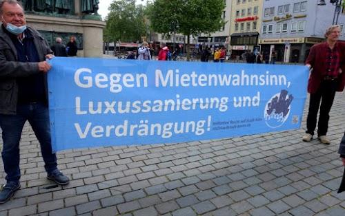 Ein Transparent zum 1. Mai 2020 «Gegen Mietenwahnsinn, Luxussanierung und Verdrängung» der «Initiative Recht auf Stadt Köln»