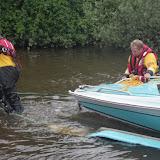 8 June 2012: Crew Members Rob Inett and James Kilburn manoeuvre the speedboat onto a trailer. Photo: RNLI Poole/Dave Riley