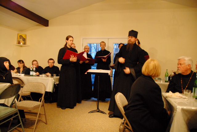Hierodeacon Herman introduces a brief concert by the Octet following the meal.