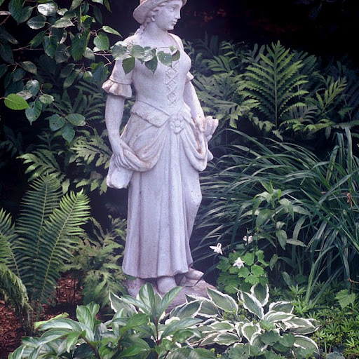 The lady watches over the garden.