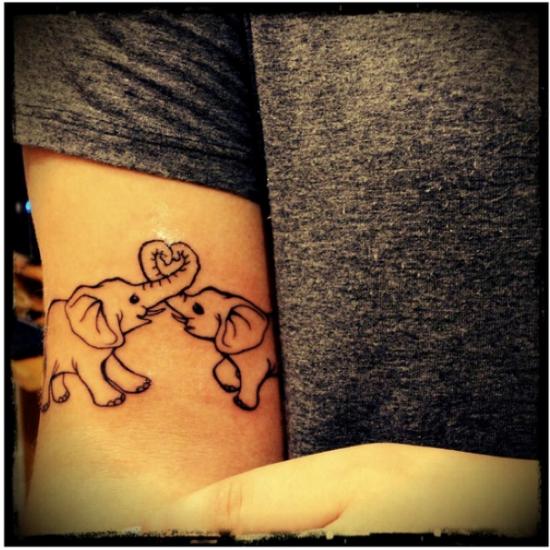 bonito_twin_elefantes_e_coraço_braço_de_tatuagem