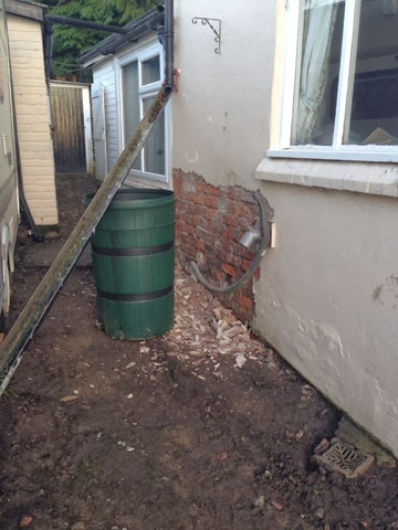 Renovating an old stone cottage: Removing concrete render