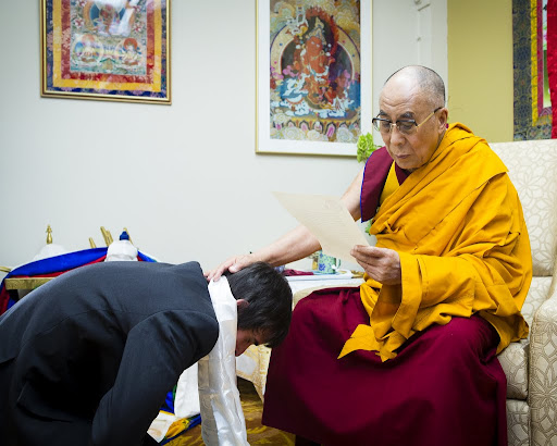 His Holiness the Dalai Lama reading a letter from Lama Zopa Rinpoche with Tenzin Ösel Hita after a body, speech and mind mandala offering, FPMT International Office, Portland, Oregon, U.S., May 10, 2013. Photo by Leah Nash.