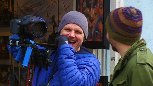 Pursuing Happiness Filmmaker Adam Shell in New Orleans. The film was shot on hand-held cameras to foster a more conversational tone.