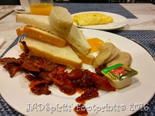 Jonjie's breakdast plate of breads, jam, butter and bacon with omelet on the side