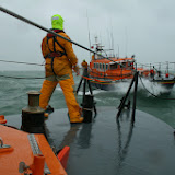 Surfing the wave. Poole ALB in a training exercise with Swanage Mersey class lifeboat - 26 January 2014.  Photo credit: RNLI Poole/Rob Inett