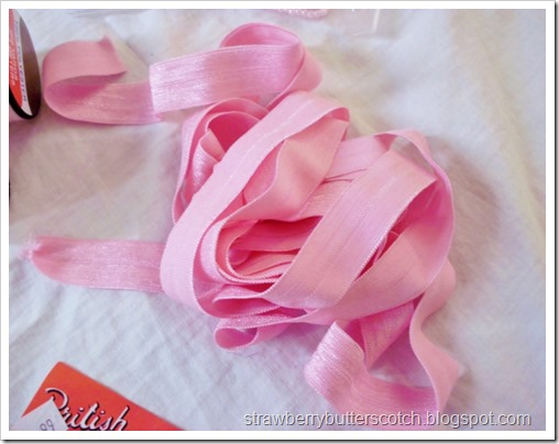 Pink fold over elastic.  Good for hair ties.