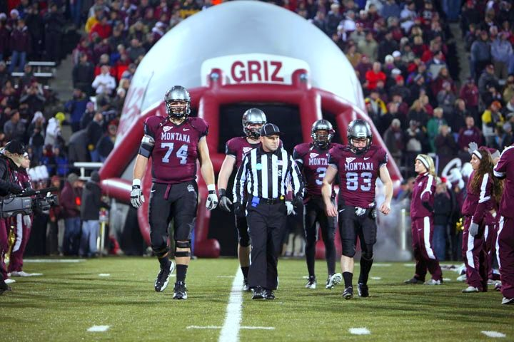 The Griz captains head to center field for the coin toss.