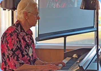 Dorothy Waddel playing the Club's Clavinova CVP-509. Photo courtesy of Dennis Lyons.