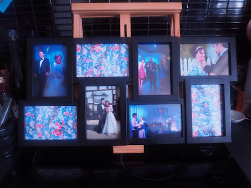 Photo frame filled with our wedding photos and blue floral print
