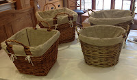 Wooden baskets with material linings.