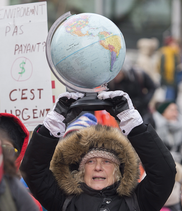 A woman holds up a globe demanding action on climate change during a demonstration in Montreal, Quebec, Canada, on Saturday, 8 December 2018. Photo: Graham Hughes / The Canadian Press / AP