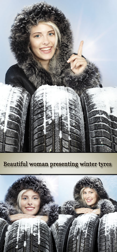 Stock Photo: Beautiful woman presenting winter tyres