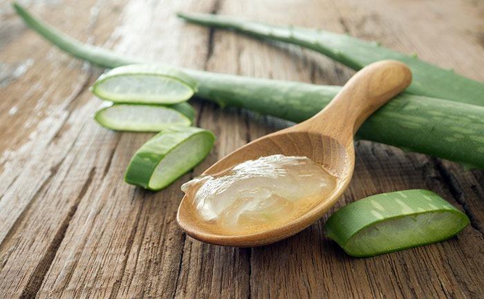 aloe vera gel on wooden spoon