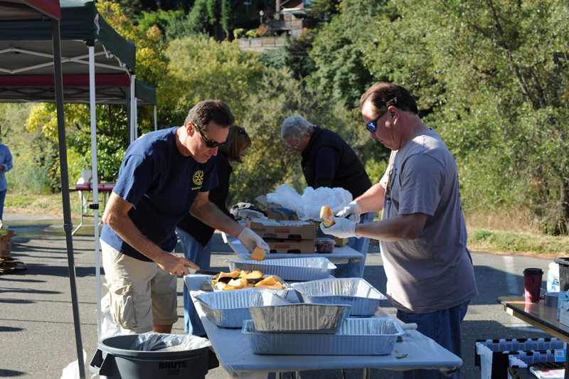President Bill and Doug Johnson preparing food