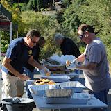 President Bill and Doug Johnson preparing food