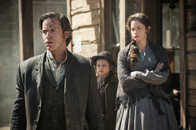 THE LONE RANGER Armie Hammer as John Reid/The Lone Ranger, Bryant Prince as Danny Reid and Ruth Wilson as Rebecca