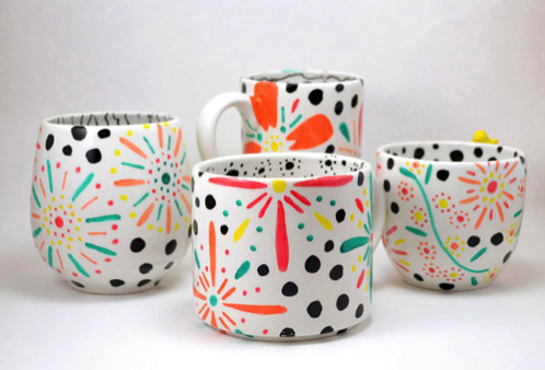 Doodled floral coffee mugs.png