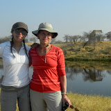 Tish and Maria in Savuti, there is a giraffe across the river