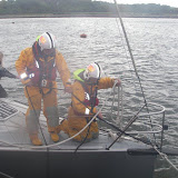 Poole crew swapping over ropes as one of the original ropes had started to fray through one of the yacht fittings. Photo: RNLI Poole/Anne Millman