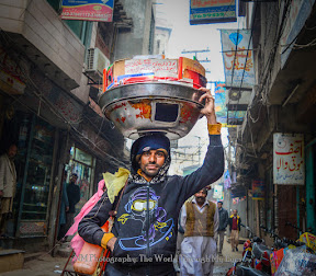 Item seller in the streets of walled city.