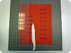 Score with a ruler and a bone folder on the dashed line of template.