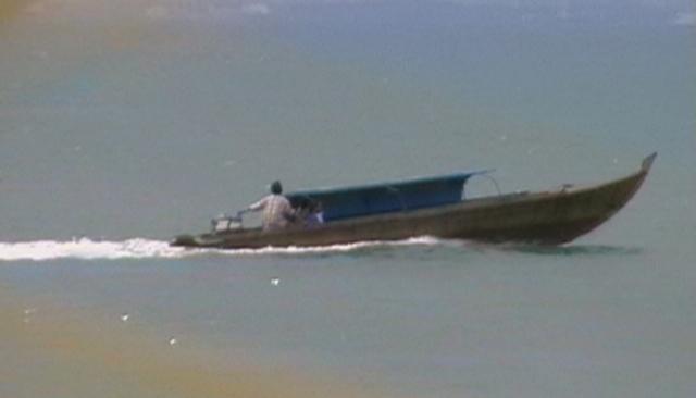 Mototboat goes back and forth below the bridge