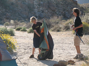 Kaiel sets up his tent.