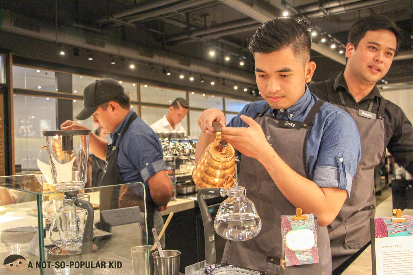 Preparing coffee using siphon in Starbucks Reserve