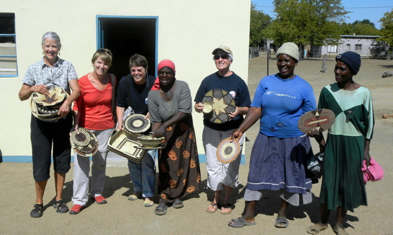 Buying hand made baskets from Batswana in Matahathane