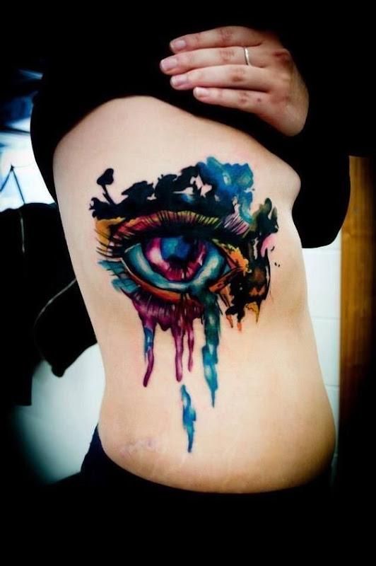 fantasia_aquarela_do_olho_do_lado_do_corpo_da_tatuagem
