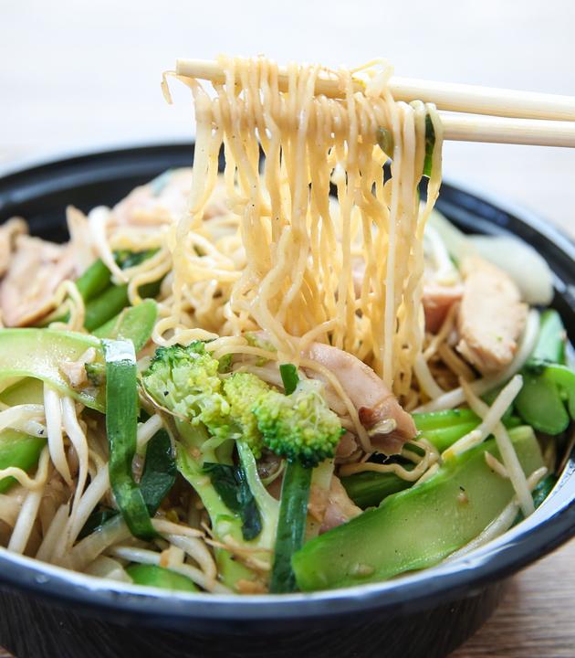 photo of chopsticks holding noodles