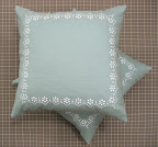 completed pillows with decorative edge