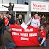 Spanduk anti nurdin di Anfield