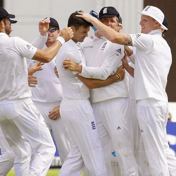 England's James Anderson, centre, celebrates taking the wicket of India's Shikhar Dhawan during the first day of the second test match between England and India at Lord's cricket ground in London, Thursday, July 17, 2014.