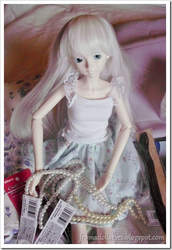 Ball Jointed Doll Showing Off Glass Pearls