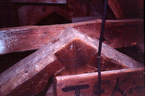 Detail of joinery in a king post truss.