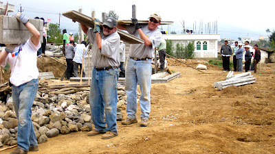 3 Gringos carrying concrete slabs. Gringo loco...Ira, Dave, Jason.Photos by TOM HART