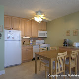Well stocked kitchen with dishwasher and granite countertops