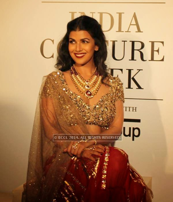 Nimrat Kaur smiles during the India Couture Week, 2014, held at Taj Palace, in New Delhi.