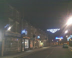 evening time and an empty streetlit A-road with xmas lights in evidence