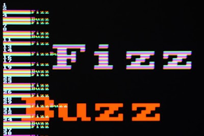 "FizzBuzz from an FPGA board. The board generates raw VGA video output with the results animated, along with the words ""Fizz"" and ""Buzz"" that bounce around the screen."