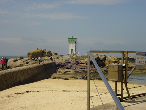 Photo: A careful walk along this concrete barrier leads to the small lighthouse.