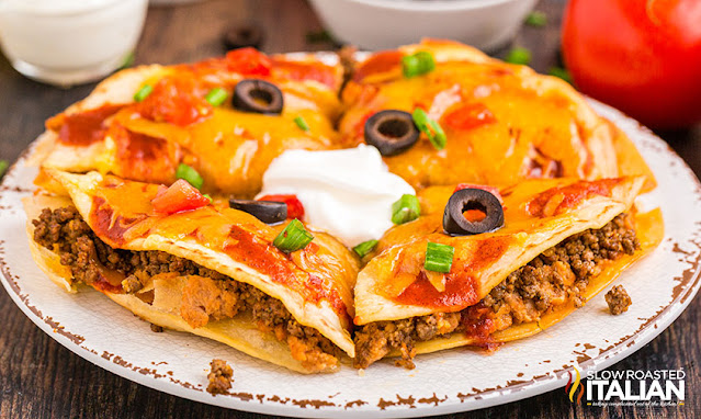 taco bell mexican pizza whole topped with olives