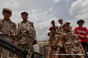 Real soldiers and toy soldiers. Friday prayer on 60 Meter Rd, Sana'a, Yemen جمعة الوفاء لأبين  في شارع الستين بصنعاء